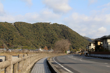 On the way to the iconic Kintai Bridge made of wood. On top of the hill is the Iwakuni Castle