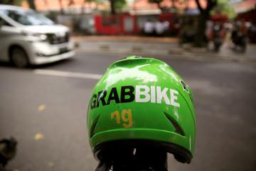 A Grab bike helmet is seen near Sudirman train station in Jakarta