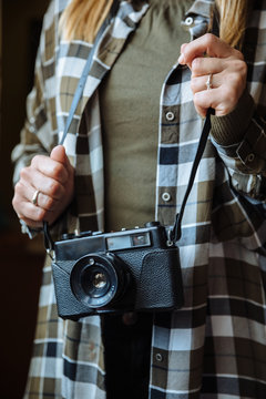 Mid section of woman with vintage photo camera