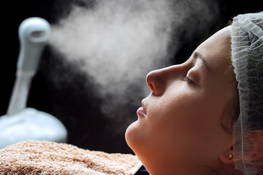 Beauty treatment of face skin with ozone facial steamer in spa center
