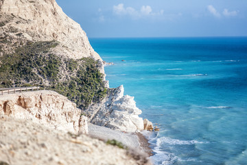 Bright blue azure water of the Mediterranean Sea, the coast with white rocks, Cyprus, the beach of Aphrodite. Beautiful seascape