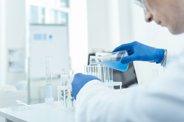 Biological research. Professional scientist conducting an experiment while workign in a lab