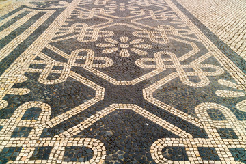 Mosaic vintage pavements in the historic city centre of Lisbon, Portugal.