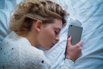 Teenager can't sleep without her smartphone