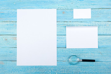 Business card. Corporate stationery set mockup. Blank textured brand ID elements on wooden table. Top view.