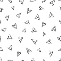 Abstract doodle pattern with hand drawn hearts.