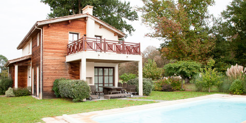 large wood house with private pool for swimming in summer day