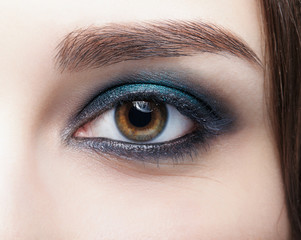 Closeup macro shot of  human female eye. Woman with natural evening vogue face beauty makeup