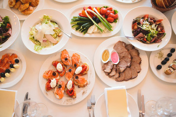 Salads and Meat Dishes on Table