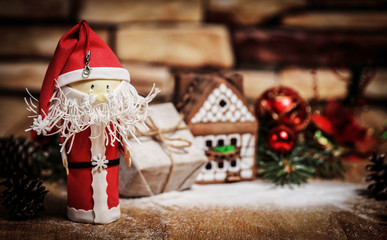 gift for Christmas ,gingerbread house, a toy Santa Claus.