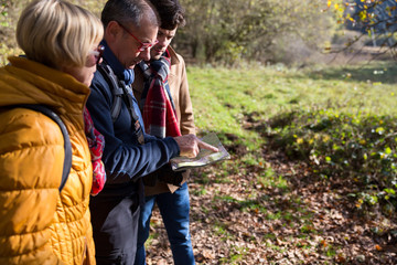 Family looking at map during nature hike