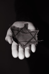 man with a ragged Jewish badge