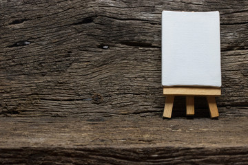 easel on wood texture background