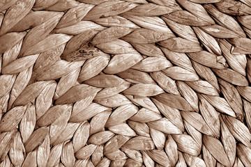 Round straw mat texture in brown tone.