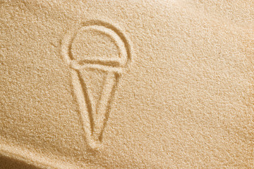 Ice cream is painted on sand. Beach background. Top view. The concept of summer, summer kanikkuly, vacation, holydays.