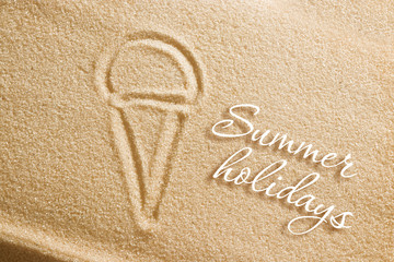 The ice cream is painted on the sand and the inscription is summer holidays. Beach background. View from above. The concept of summer, summer kanikkuly, vacation, holydays.