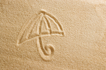 The umbrella is painted on the sand and the inscription is summer holidays. Beach background. View from above. The concept of summer, summer kanikkuly, vacation, holydays.