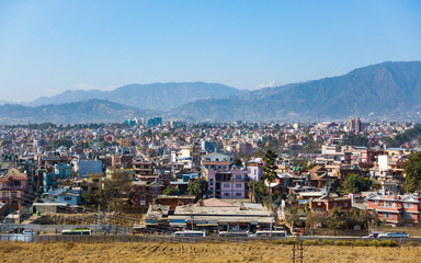 Part of Kathmandu city as seen from a vantage point, Nepal. Hills and mountains in the background.