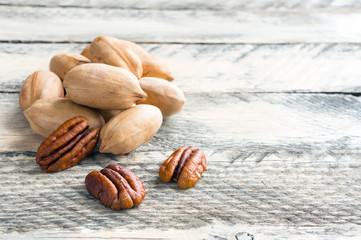 Pecan nuts. Closeup rustic food photo with copy space.