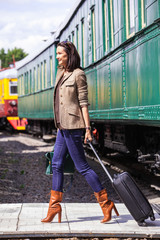 beautiful adult woman with a luggage