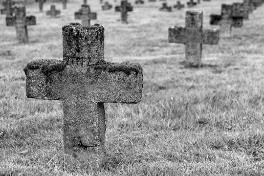 World war one cemetery in Belarus, stone cross on a grave of German soldier