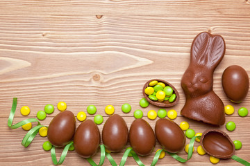 Easter eggs and  bunny on wooden background.