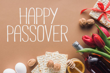 top view of happy passover greeting and matza on brown, Passover Tale concept