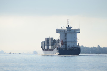 cargo container ship entering port of Riga