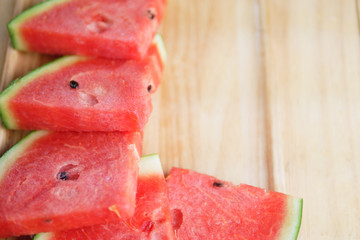 Sliced red watermelon on wooden background