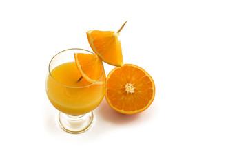 Glass of orange juice with oranges stock images. Orange on a white background. Juicy pieces of oranges