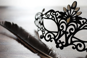Black mask on the wooden background