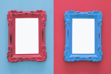 Vintage blank blue and red photo frames over double colorful background. Ready for photography montage. Top view from above.