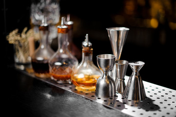 Barman essentials standing at the steel bar counter