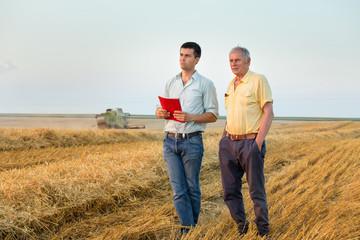 Farmers on wheat harvest