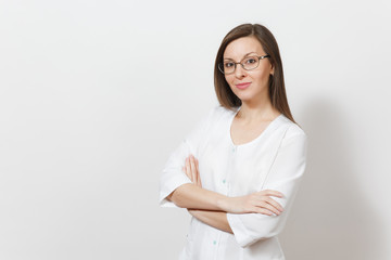 Smiling happy confident attractive young doctor woman with glasses isolated on white background. Female doctor in medical gown holding hands crossed. Healthcare personnel, health, medicine concept.