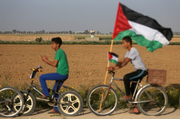 Palestinians attend a marathon near the border with Israel, in the southern Gaza Strip