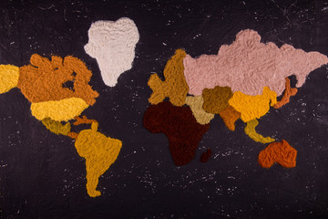 The world map which is laid out from spices of different color