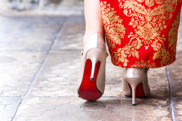 red cheongsam with white high heels shoe,Chinatown bangkok,25 Mar 2018,10.45AM.
