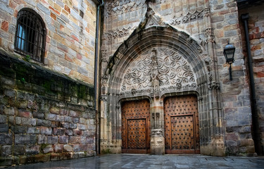 amazing old medieval architecture with wooden door in cathedral of Bilbao. Spain.
