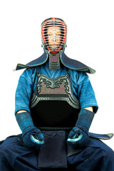 Male wearing a kendo armor with helmet and gloves, sitting position.
