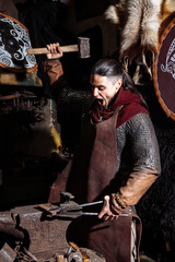 Viking sword handles sword rack reenactment forge smith warrior weapon outfit ax shield skin fire hearth one man