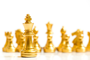 Gold king chess piece stand in front of team on white background (Concept for leadership, management)