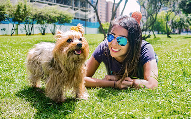 Latin woman with her faithful canine friend  Yorkshire Terrier
