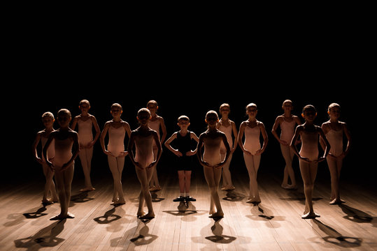 A large group of children rehearsing and dancing the ballet
