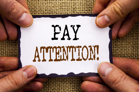 Word, writing, text  Pay Attention. Conceptual photo Be Careful Beware Mindful Alarm written on Sticky Note Paper Holding Hand with Finger.