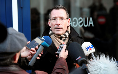 Prosecutor Georg Guentge talks to the press at the prison in Neumuenster