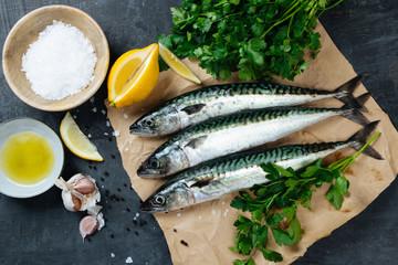 Fresh mackerel fish with ingredients to cook