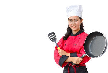 Smiling chef woman in red uniform holding cooking utensils