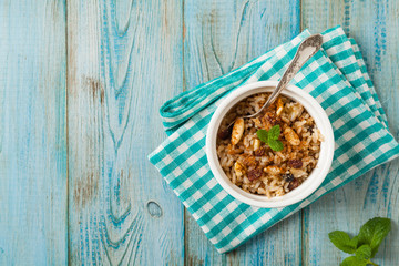 Traditional, mexican baked sweet rice, with almonds, raisins and walnuts.