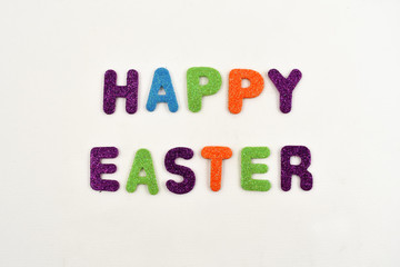 Happy Easter stock images. Colored inscription Happy Easter. Happy Easter sign on a white background